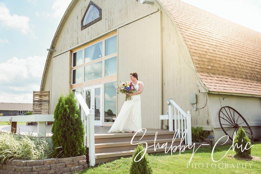 bride-outside-barn-shabby-chic-photography-debbies-celebration-barn